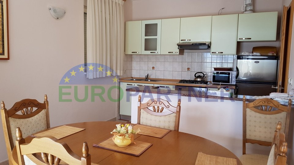 House with an apartements on an excellent location, first row to the sea, near Zadar