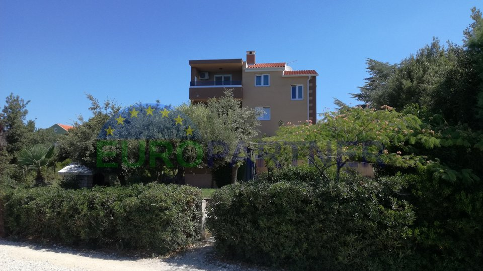 House with 4 apartments on a best location, first row to the sea, near Zadar