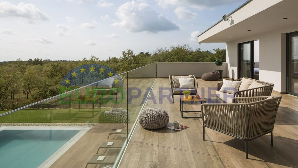 Modern villa with a swimming pool surrounded by greenery, 14 km from the center of the city
