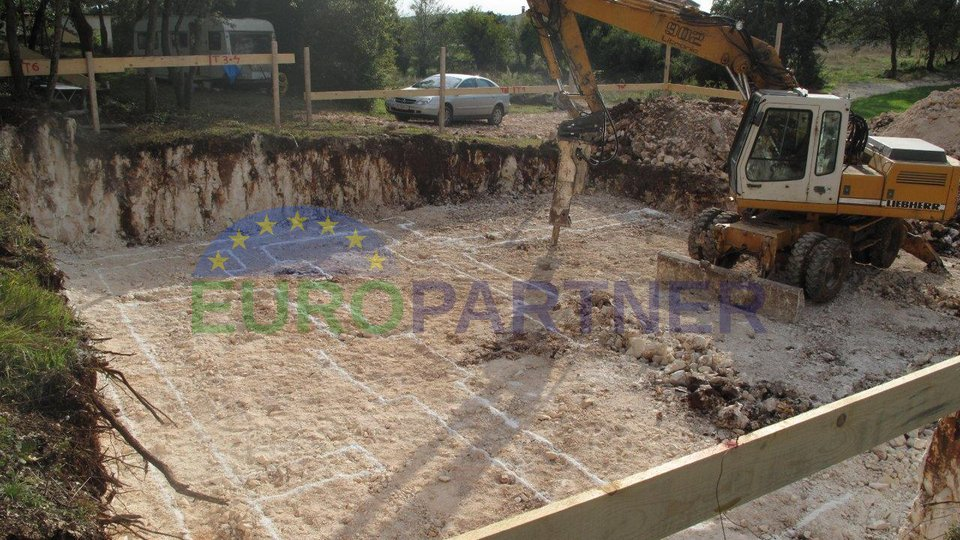 Investment project with paid utilities and building permits!